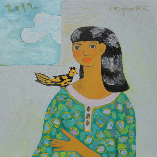 Young girl with bird